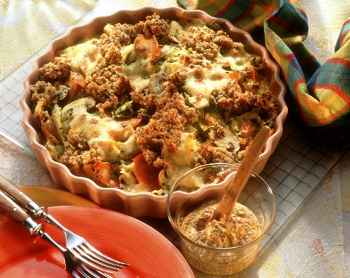Vegetable gratin with mushrooms and mustard crust