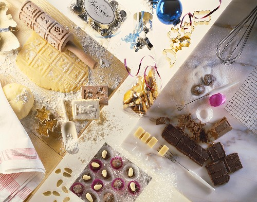 Christmas baking scene with biscuits, chocolates & moulds