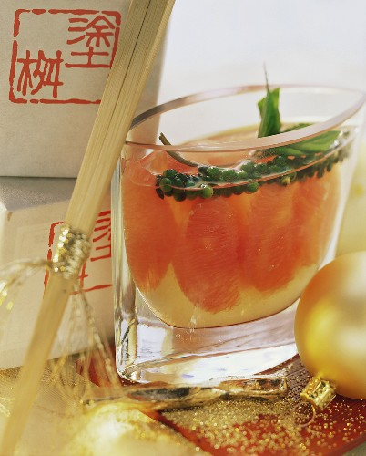 Pink grapefruits preserved in sake with pepper trusses