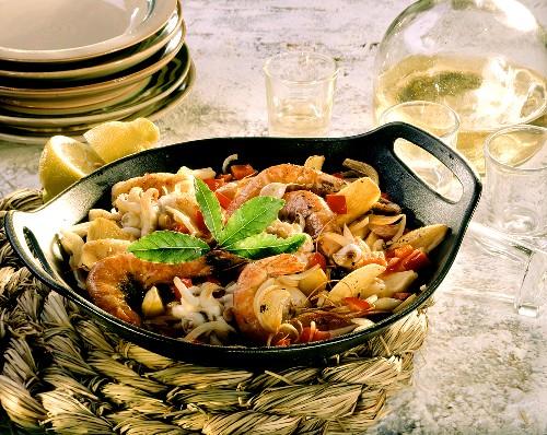 Pan-cooked fish dish with monkfish, cuttlefish & gambas