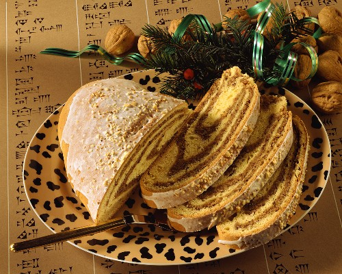Sugar candy & nut striezel (plait) in slices on plate