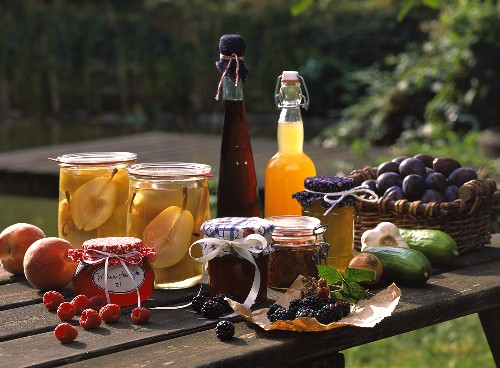 Still life with bottled fruit, jelly, liqueur & juice