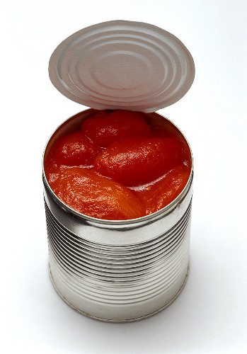 Peeled tomatoes in an opened tin