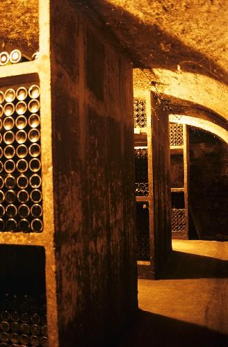 Wine bottles stored in stone racks, Winzerhof Gietzen, Mosel