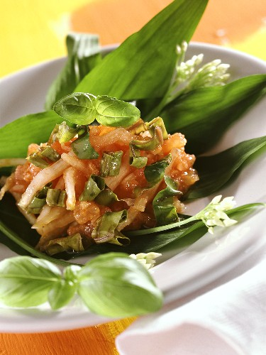 Tomato salsa with chard on ramsons (wild garlic) leaves