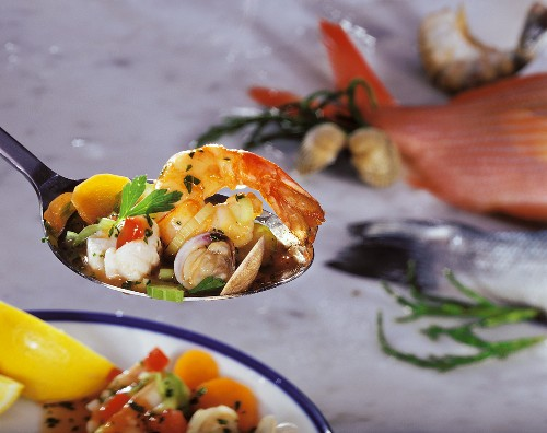 Fish and seafood ragout on spoon
