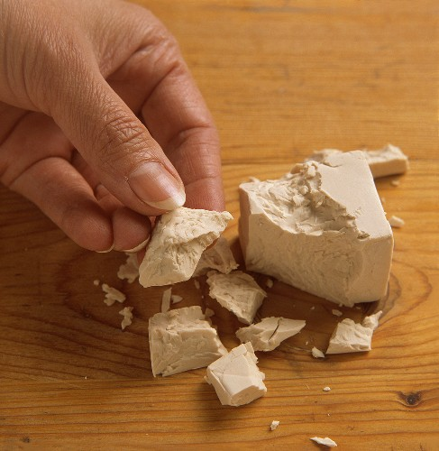 Crumbling a cube of yeast