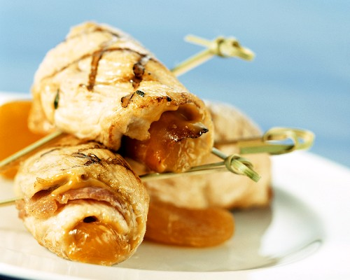 Barbecued turkey rolls with ham and apricot stuffing