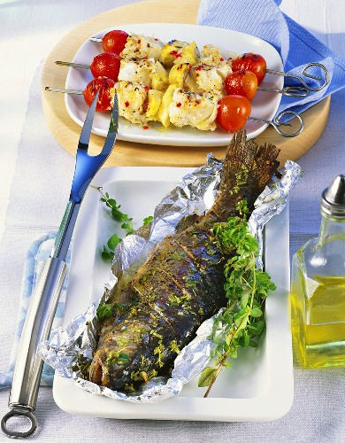 Barbecued trout with herbs and fish and banana kebabs