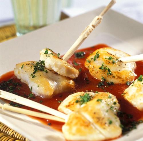 Fried monkfish cheeks on tomato sauce