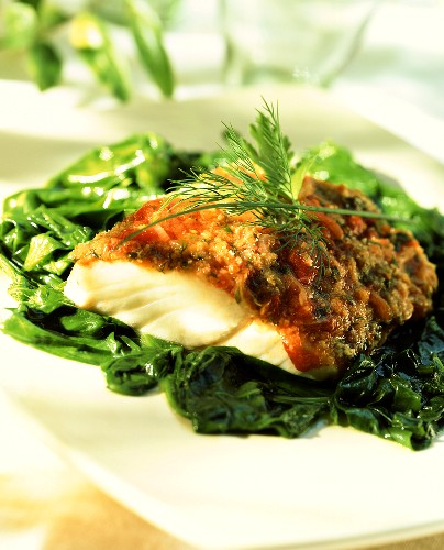 Alaska pollock fillet with herb crust on spinach