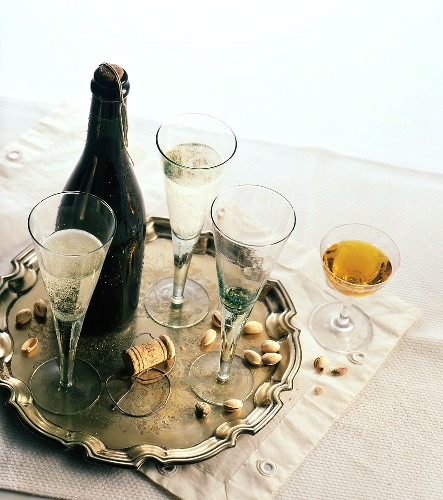 Bottle of sparkling wine with glasses and an aperitif