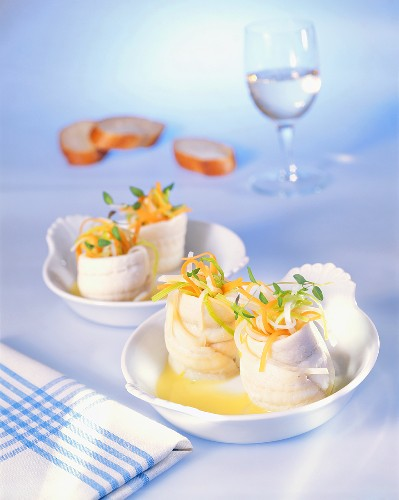 Poached plaice rolls filled with julienne root vegetables