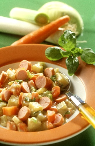 Spring vegetable stew with sausages