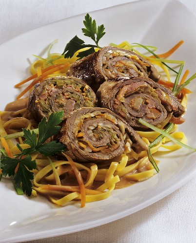 Stuffed beef roulades on julienne vegetables