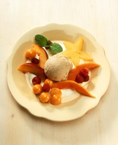 Peanut ice cream with fruit garnish