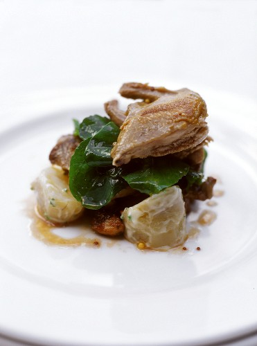 Quails with spinach, potatoes and mustard dressing
