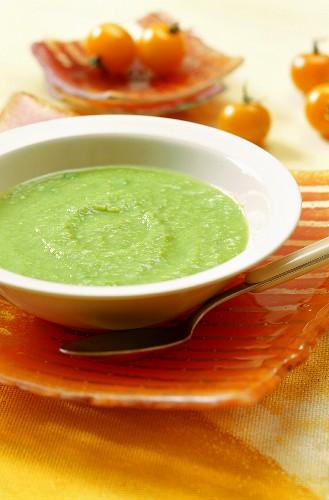 Creamed pea soup on orange service plate