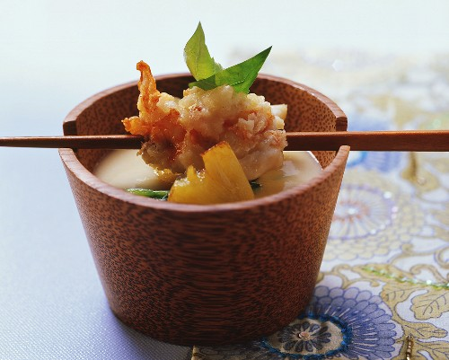 Spiny lobster in almond tempura over polenta soup
