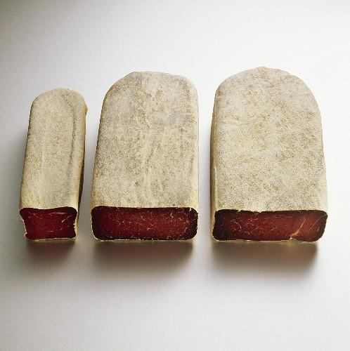Three pieces of dry-cured beef (Bündnerfleisch)