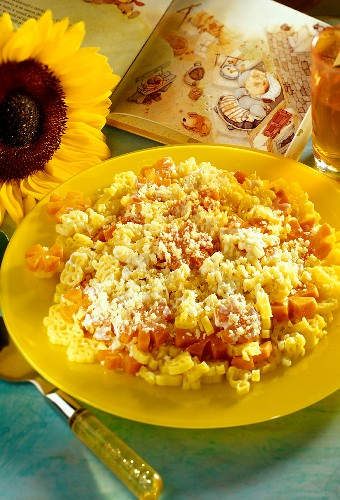 Pasta shapes with carrots and cheese