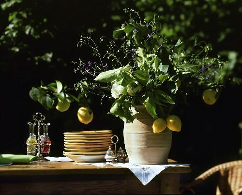 Lemon bouquet in terracotta vase on buffet table
