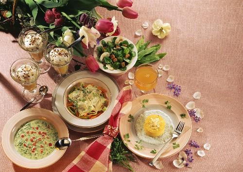 Menu: herb soup, corn salad, ravioli, apple puree, souffle