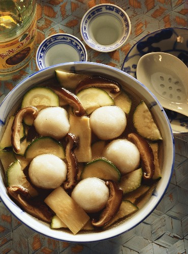 Soup with fish balls, bamboo sprouts, courgettes & mushrooms