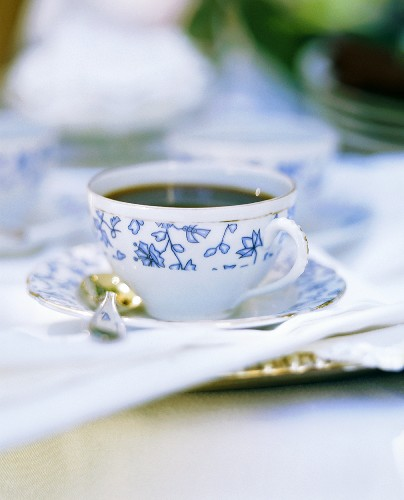 Black coffee in white china cup with blue pattern
