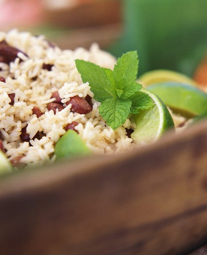 Rice with red beans, mint leaves and lime slices