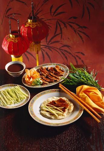 Peking duck with flat bread, spring onions, soya bean paste