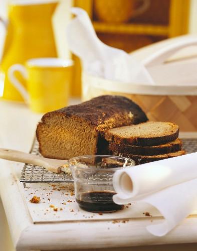 Finnish malt bread on cake rack; syrup for glazing