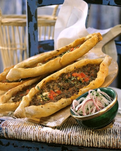 Turkish pizza with minced lamb & bowl of onions