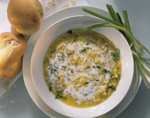 Barley soup with herbs, spring onions, saffron & cream