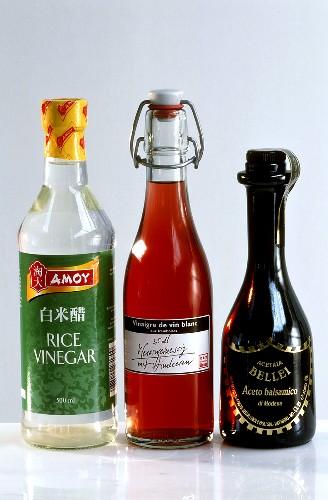 Rice, raspberry and balsamic vinegar in bottles