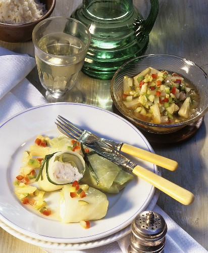 White cabbage rolls with salmon and pickled gherkins