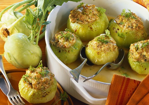 Kohlrabi with sausage stuffing on plate and in baking dish
