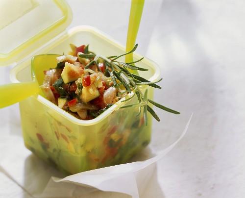 Marinated Mediterranean vegetables & rosemary in picnic box
