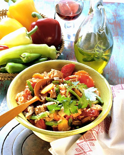 Rice with veal and vegetables; olive oil; peppers