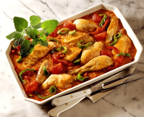 Chicken with chocolate, peppers and sesame