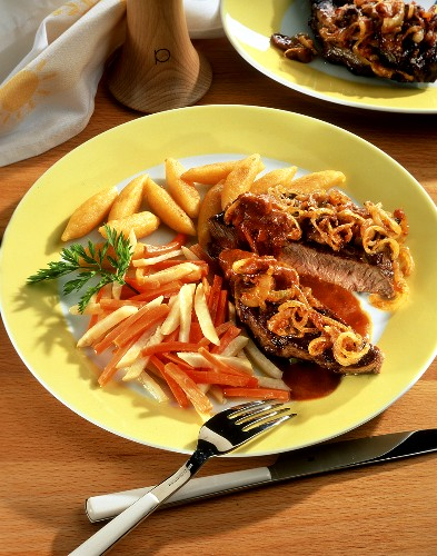 Steak with onions, root vegetables and potato noodles