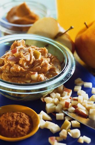 Apple, raisin and peanut butter spread in glass bowl