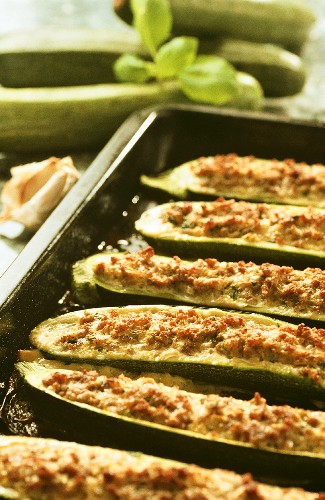 Stuffed courgettes on baking tray