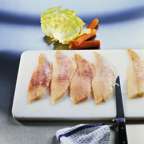 Preparing redfish fillets