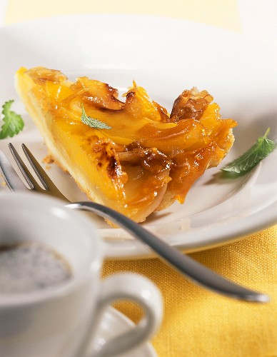 Piece of mango and apple tart with caramelised walnuts
