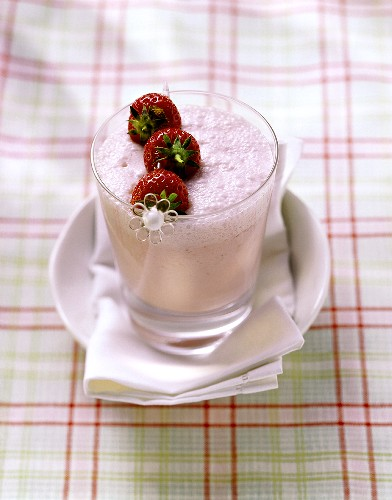 Strawberry shake with skewered fruit