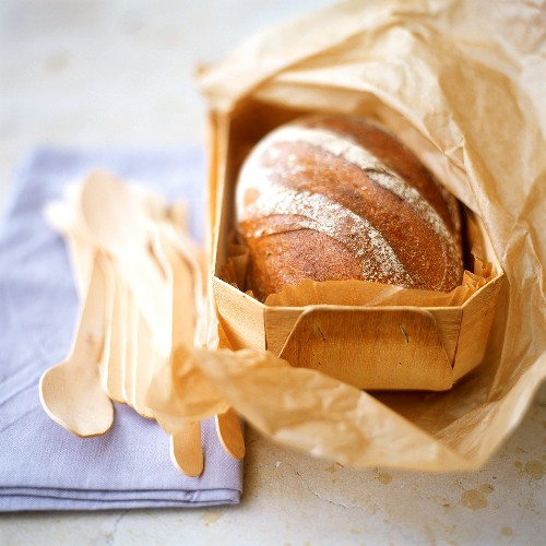 Brown bread in chip basket with baking paper