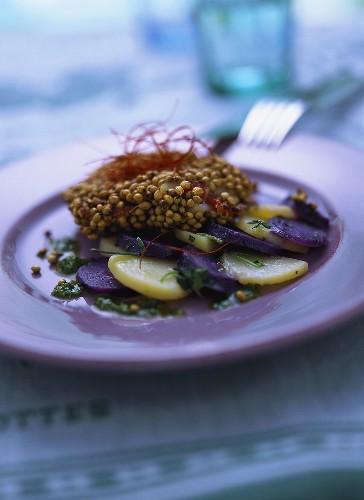 Monkfish fillets with hemp seed and potato salad