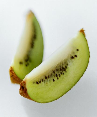 Two wedges of kiwi fruit