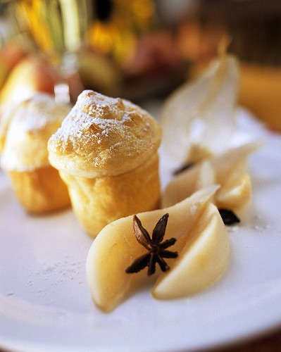 Pfitzauf (German muffin) with icing sugar and pear compote